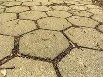 Closeup of hexagonal stone sidewalk texture background Royalty Free Stock Images