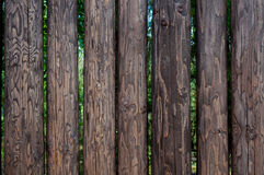 Closeup high wooden fence of logs in countryland Stock Image