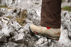 Closeup of Hiking Boot on rock. Closeup of a shoe that is standing on a rock Stock Photo