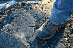 Closeup of a hiking boot on rocky ground Royalty Free Stock Images