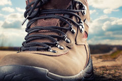Hiking boot outdoor. Closeup of hiking boot standing outdoor Stock Photo
