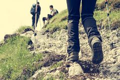 Closeup of hiking shoes. Closeup of trekking shoes. Person ascending a rocky road Stock Photography