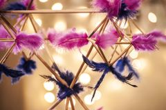 Closeup of himmeli- baltic traditional Christmas decoration from reeds and colorful bird feathers. Closeup of himmeli- latvian and scandinavian traditional stock photo