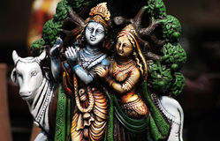 Closeup of Hindu Gods Krishna and Radha. With cow Royalty Free Stock Photo