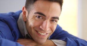 Closeup of Hispanic man sitting at desk Stock Photos