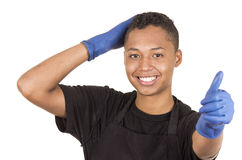 Closeup hispanic young man wearing blue cleaning Stock Images