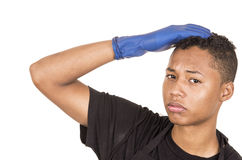 Closeup hispanic young man wearing blue cleaning Royalty Free Stock Image