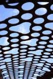 Closeup of holes in iron sieve Stock Photo