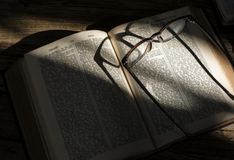 Closeup of holy bible with eyeglasses on Royalty Free Stock Photography