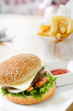 Closeup of home made burgers on table background Royalty Free Stock Photo