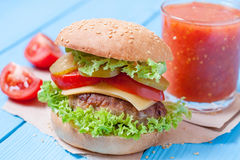 Closeup of home made burgers. On a wooden table Stock Photography