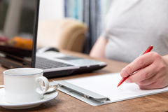 Closeup from a home office with a notebook and a notepad Royalty Free Stock Image
