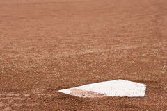 Closeup of home plate at baseball diamond Royalty Free Stock Photos