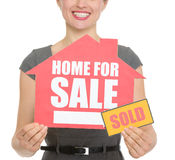 Closeup on home for sale sold sign Royalty Free Stock Photos