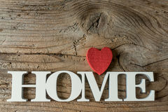 Closeup of home word against wooden background Stock Images