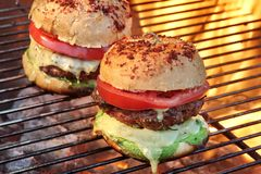 Closeup of Homemade Burgers On Hot BBQ Grill Royalty Free Stock Image