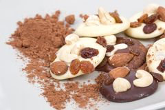 Closeup of homemade chocolate cookies with nuts and dried fruits in composition royalty free stock photo