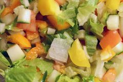 Homemade Fresh Chopped Vegan Salad. Closeup of a homemade chopped salad including salad, cucumber and peppers. Photo is taken from above and it demonstrates the royalty free stock photos