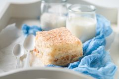 Closeup of homemade coconut cake with nuts and foam stock photo