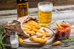 Closeup of homemade fresh fries with cold beer Royalty Free Stock Images