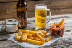 Closeup of homemade fresh fries with cold beer Royalty Free Stock Photos