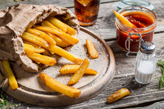 Closeup of homemade fresh fries with cold drink Stock Photos