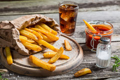Closeup of homemade fries with cold drink Royalty Free Stock Photography
