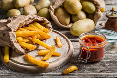 Closeup of homemade fries with ketchup and salt Stock Photography