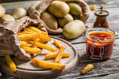 Closeup of homemade fries with ketchup and salt Royalty Free Stock Photo
