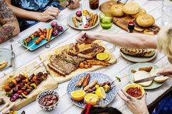 Closeup of homemade grilled food on wooden table summer party Stock Photo