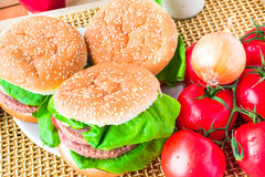 Closeup homemade hamburger fresh vegetables Stock Image