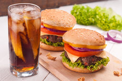 Closeup of homemade hamburger with fresh vegetables. Royalty Free Stock Photography