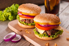 Closeup of homemade hamburger with fresh vegetables. Stock Photography