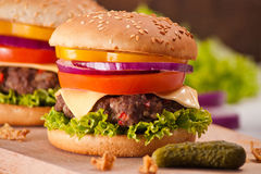 Closeup of homemade hamburger with fresh vegetables. Royalty Free Stock Image