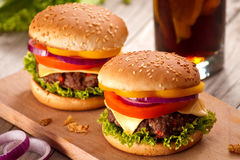 Closeup of homemade hamburger with fresh vegetables. Stock Photo