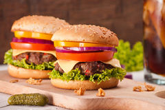 Closeup of homemade hamburger with fresh vegetables. Stock Photos