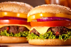 Closeup of homemade hamburger with fresh vegetables. Stock Image