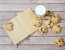 Closeup of homemade moms chocolate cookies with glass of milk and vintage notebook Royalty Free Stock Photos