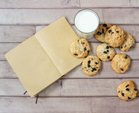 Closeup of homemade moms chocolate cookies with glass of milk and vintage notebook Royalty Free Stock Photography