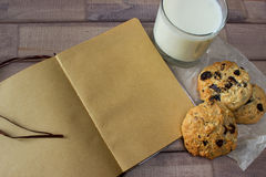 Closeup of homemade moms chocolate cookies with glass of milk and vintage notebook Stock Images
