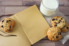Closeup of homemade moms chocolate cookies with glass of milk and vintage notebook Stock Image