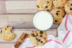 Closeup of homemade moms chocolate cookies with spices and glass of milk Royalty Free Stock Photography
