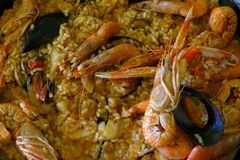 Closeup of homemade paella - a traditional Spanish rice dish with seafood stock photos