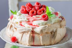 Homemade and rustic Pavlova cake made of mascarpone and berries. Closeup of homemade and rustic Pavlova cake made of mascarpone and berries stock images