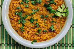 Closeup of a homemade vegan lentil stew in a white plate Stock Photos