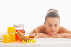 Closeup on honey spa therapy ingredients and woman in background Stock Photography