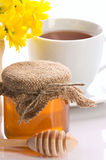 Closeup of honey,  tea and flower Stock Images