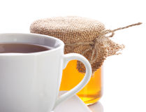 Closeup of honey and tea Royalty Free Stock Image