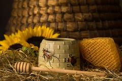 Closeup of honeycomb and honey pot royalty free stock photo