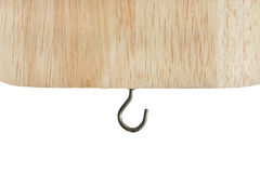 Closeup hook stick wooden plate. Royalty Free Stock Image